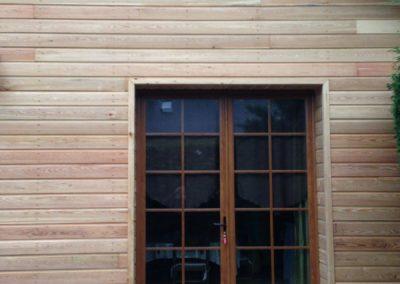 Porte fenêtre en PVC plaxé chêne avec petits bois intégrés – RUE – 80