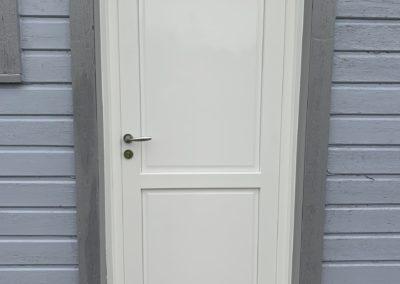 Porte d'entrée pleine en PVC à Quend